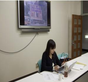 写真:報告を行う櫻田氏