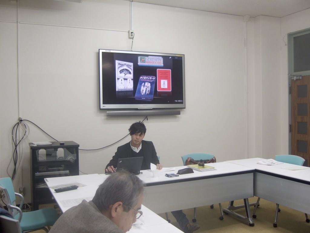 写真1:報告する小木曽氏